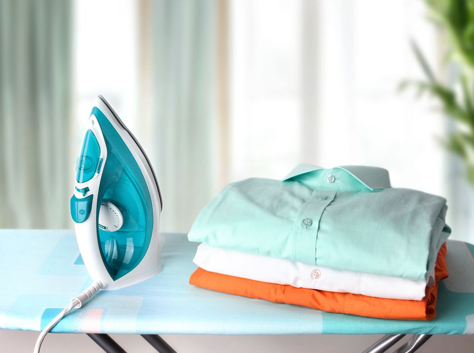 Household concept.Ironing board with clothes.