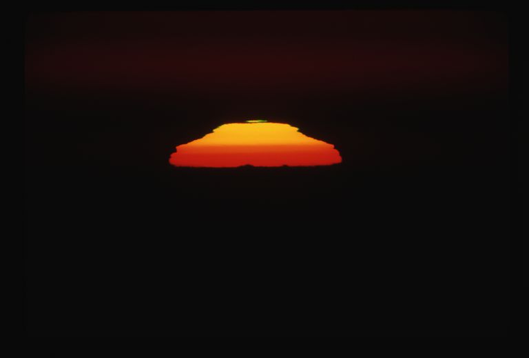 The green flash most often appears as a thin band of green at the top of a sunrise or sunset.