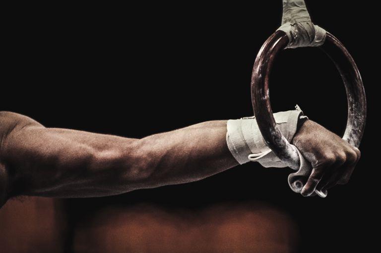 Gymnast performing on still rings