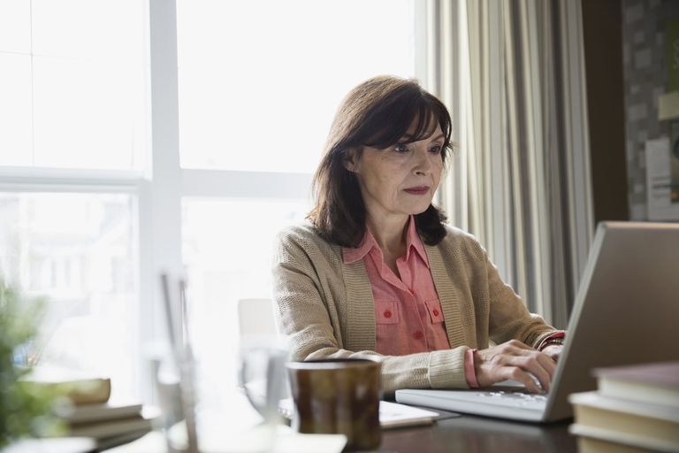 Woman using laptop in home office