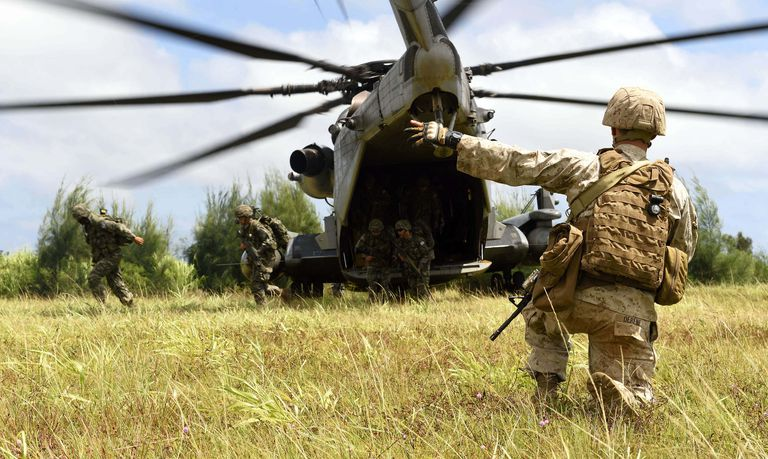 Marines exiting helicopter