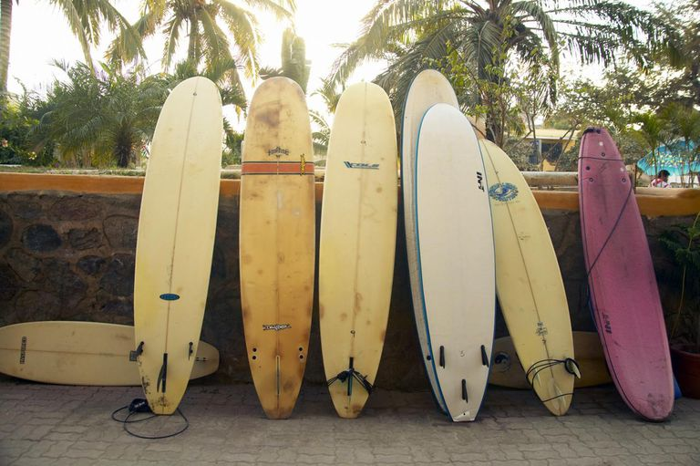 Surfboards leaning on wall