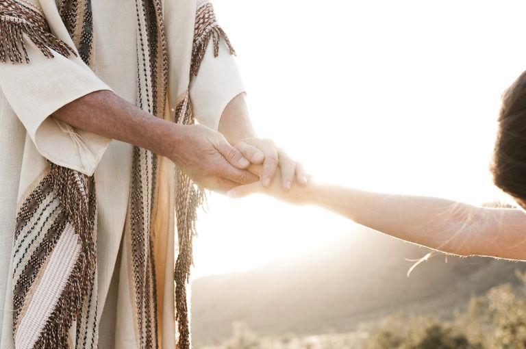 photo implying Jesus holding someone's hand