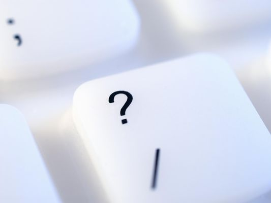 Question mark key on keyboard close-up
