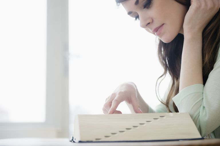 woman reading dictionary