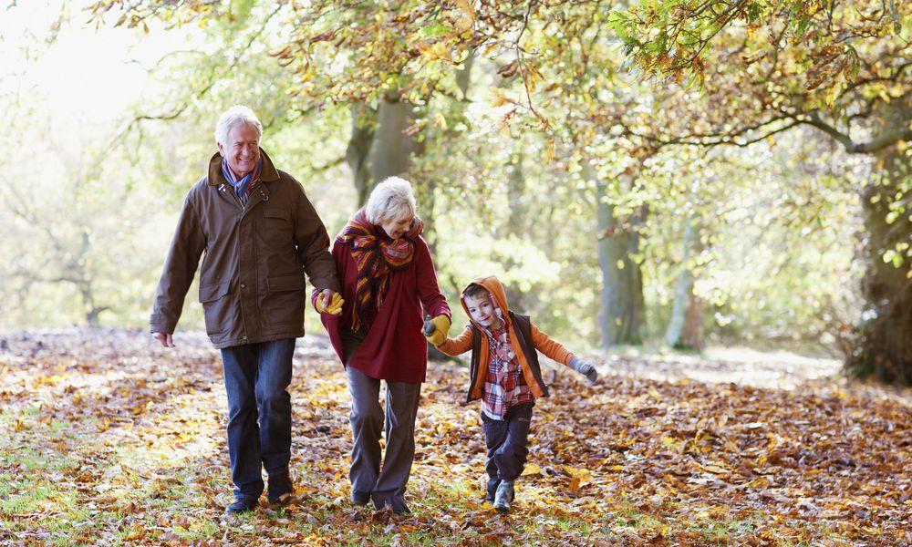 Grandparents walking with grandchild