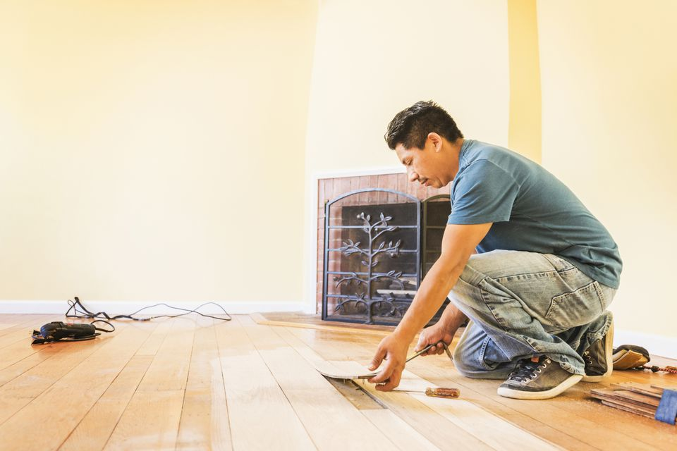 Tradesman Installing a Wood Floor