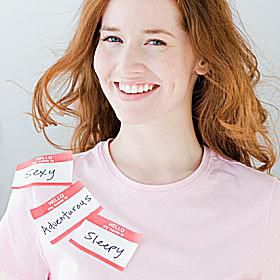 Woman wearing multiple name tags.