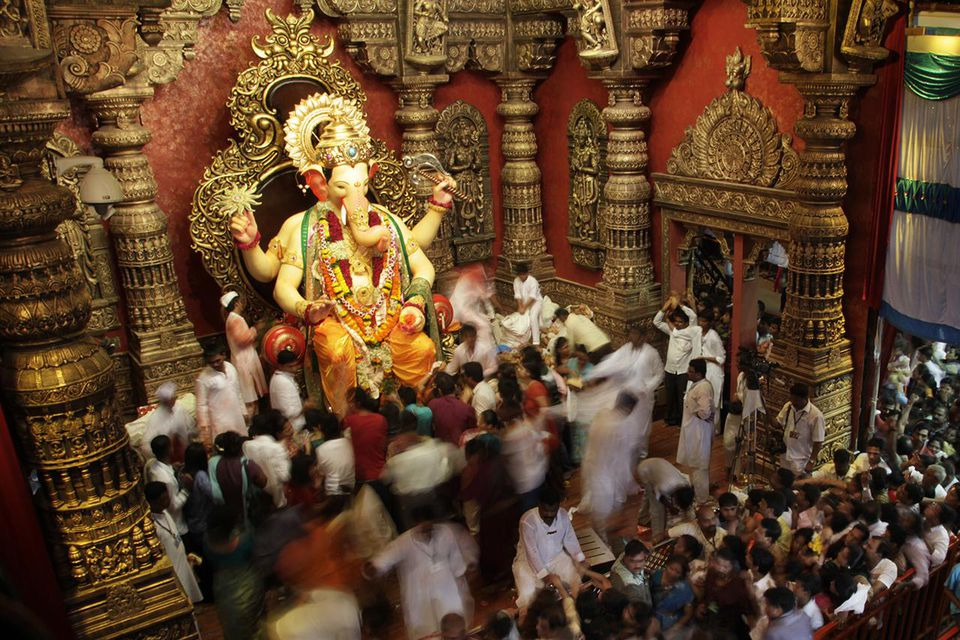 Hindu devotees worship the Lalbaugcha Raja, one of the most popular ganesha idols on the first day of Ganpati festival September 11, 2010 in Mumbai, India.