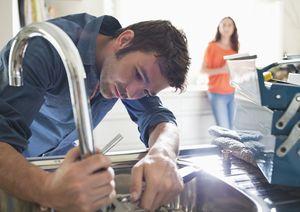 Plumber working on kitchen sink
