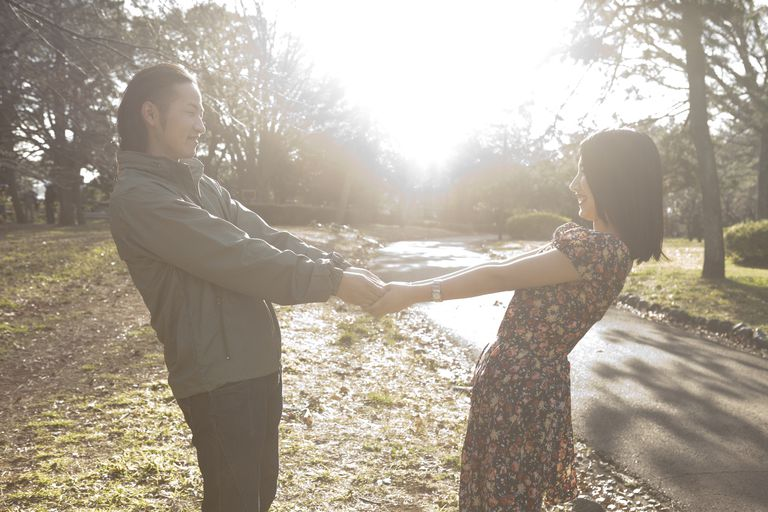 Couple dancing in the park, more likely to dance well when ovulating
