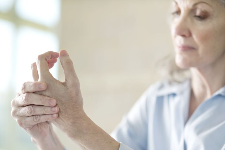 Senior woman holding painful hand