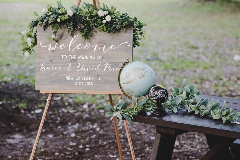 rustic wedding sign with greenery