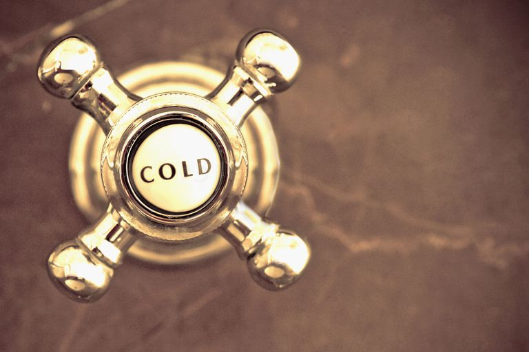 close up of a cold water shower knob