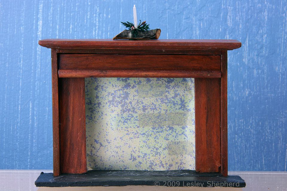 Classic mahogany finish on a dolls house fireplace made from a simple unstained dolls kitchen hutch
