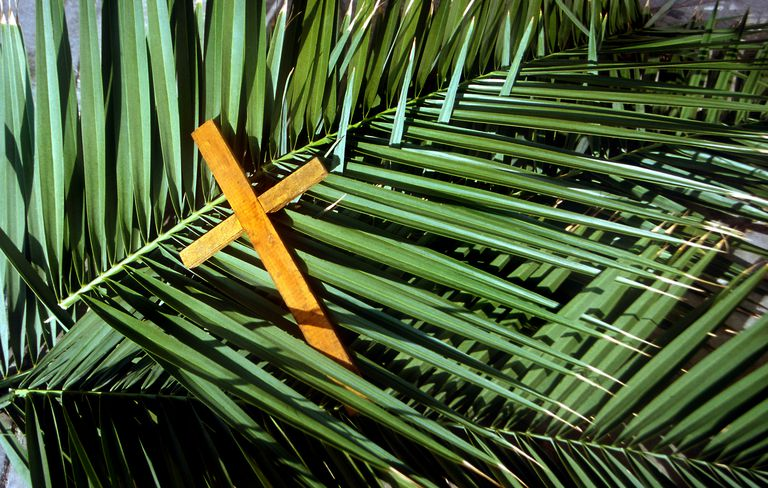 Wooden Cross on palm leafs Palm Sunday