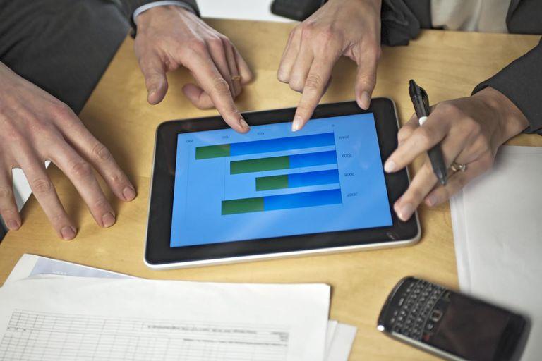 Hands around digital tablet tablet