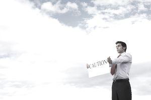 Man holding caution sign