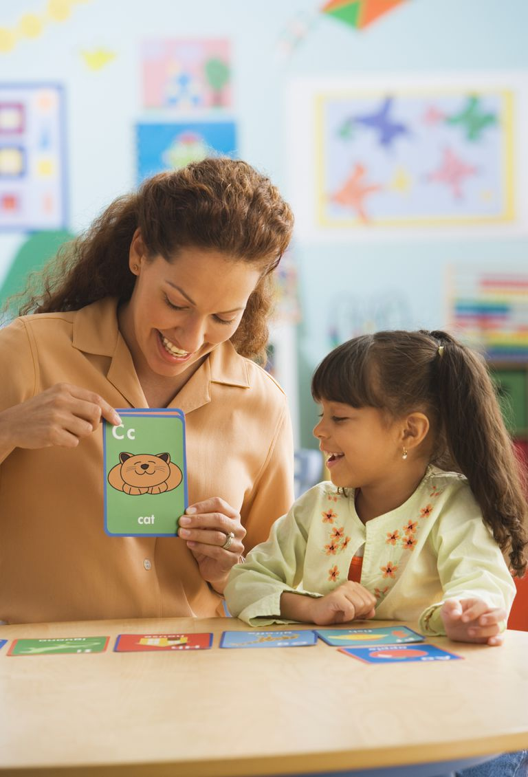 teacher and student with flash cards