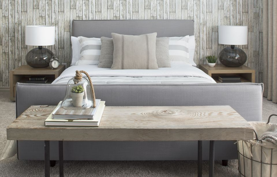 Elegant neutral bed and wood bench