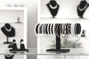 USA, Illinois, Metamora, bracelets and rings on display in jewelry store