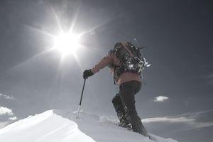 Man climbing snowy mountain
