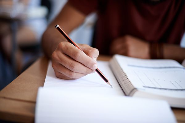 Person completing a self-help workbook.