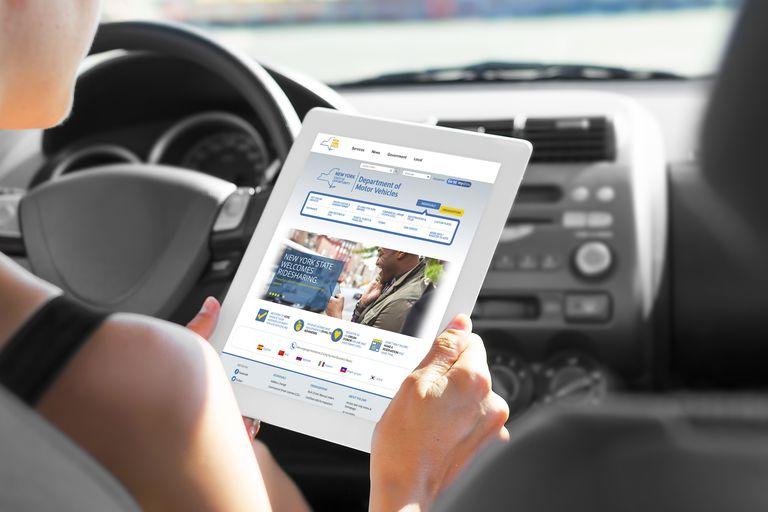 Woman registering her car online