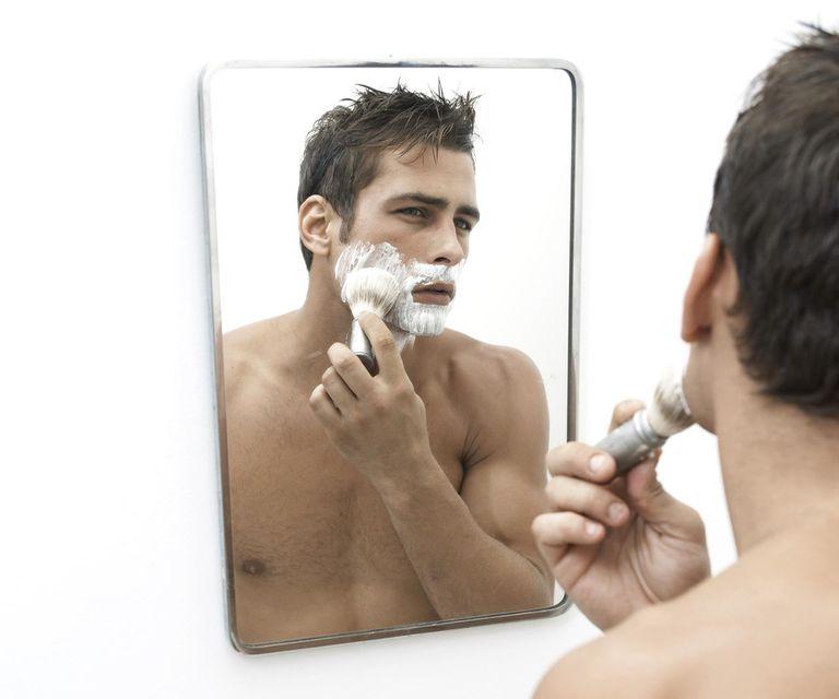 Mid adult man applying shaving cream