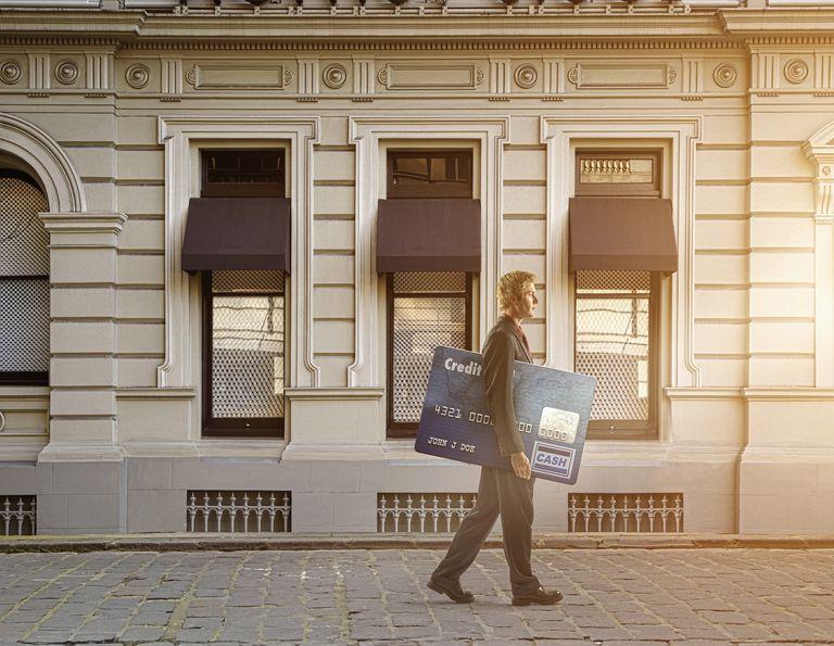 Man carrying large credit card