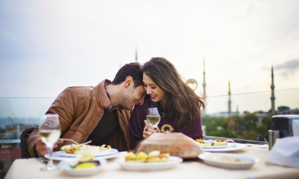 Couple having romantic meal on rooftop