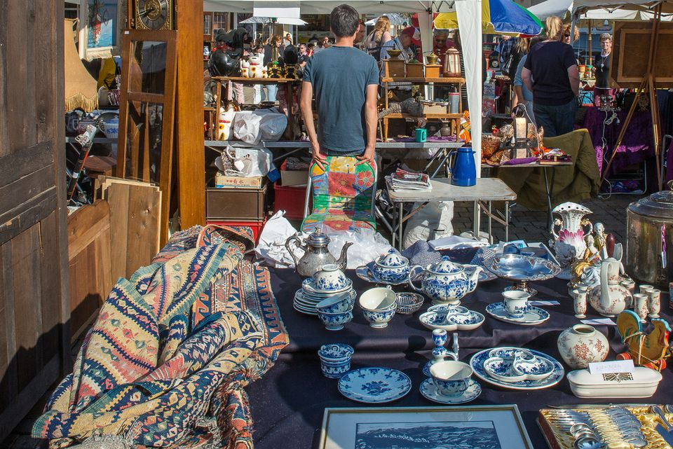 shoppers browsing antiques at flea market