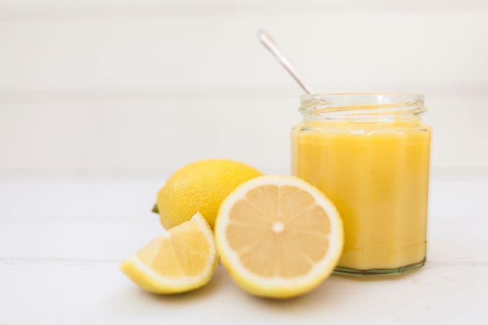 Homemade lemon curd and lemons