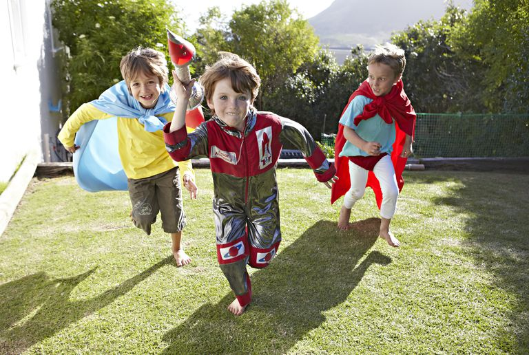 physical play - kids running outside in costume