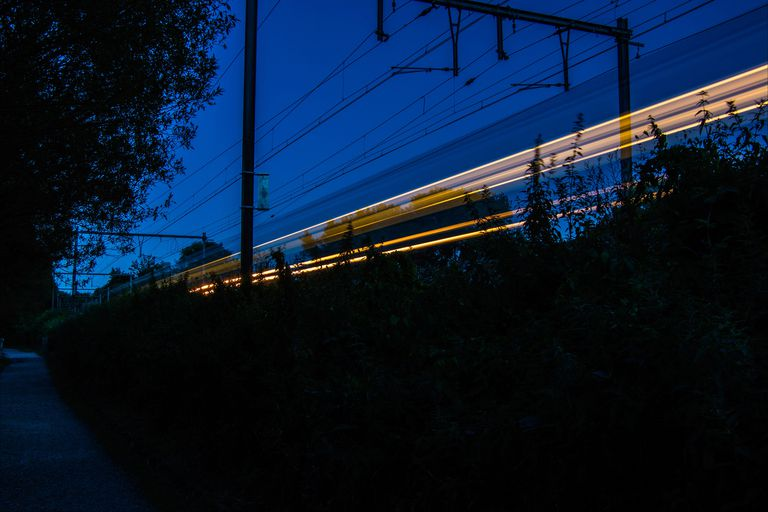 Illustration of high speed cables at night in a residential neighborhood