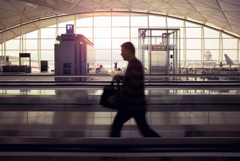 Man walking through Hong Kong Airport