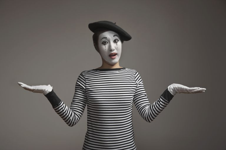 Woman in mime costume with arms outstretched