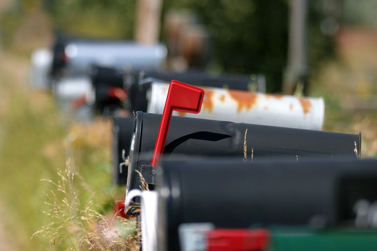 mailboxes lined up, flagged box as object of focus.