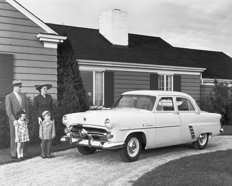 Family in Driveway with Their Ford