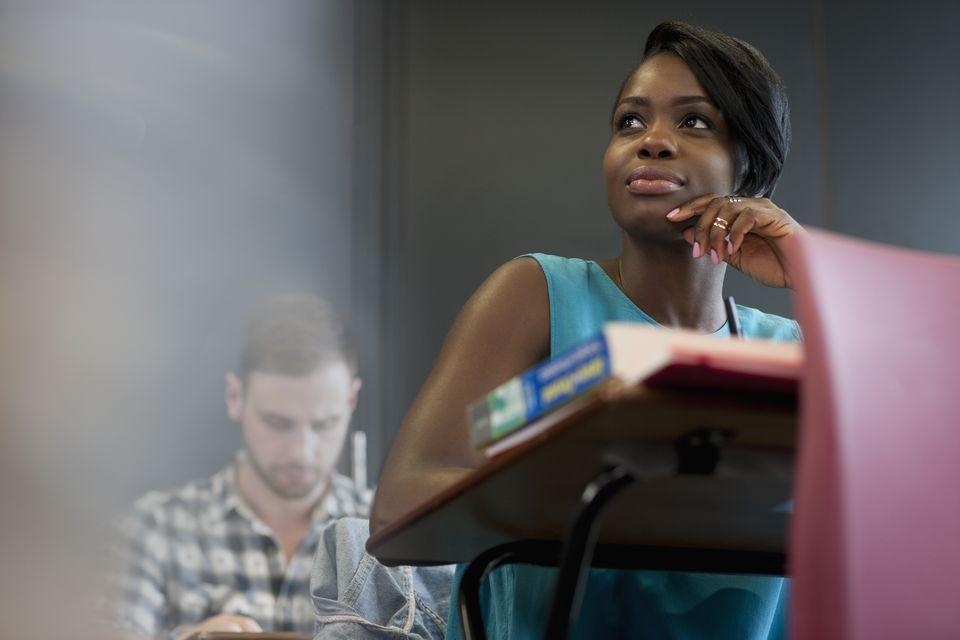 Female scholarship recipient sitting in class