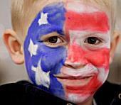 American flag face paint on little boy.