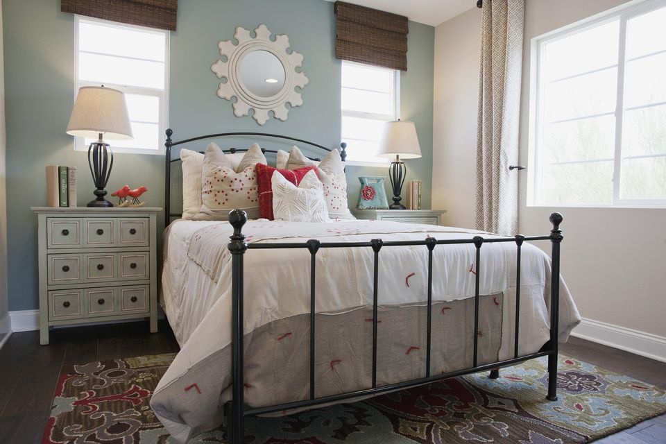 Adorable bedroom with wrought-iron bed