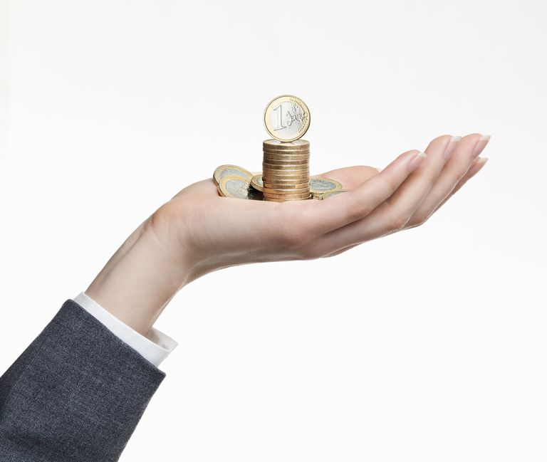 coins in woman's hand