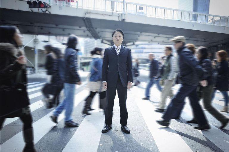 Businessman standing on a pedestrian crossing