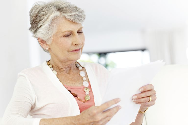 Woman looking at her Social Security benefit statement.