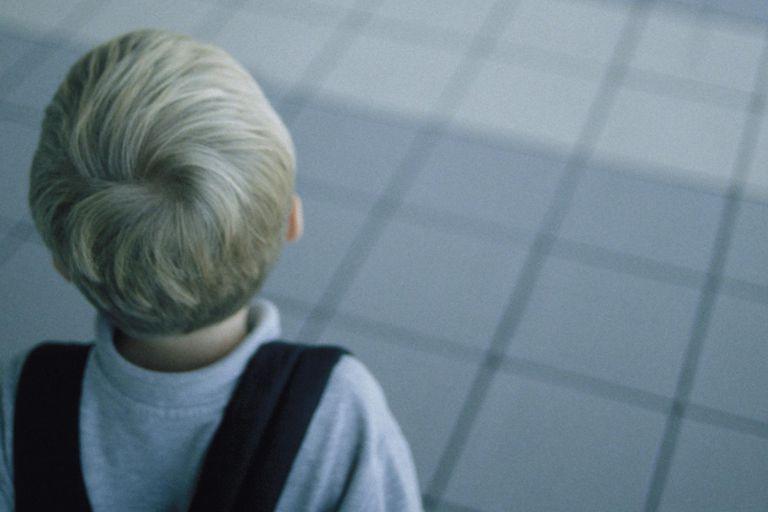 Boy in Empty Airport Terminal