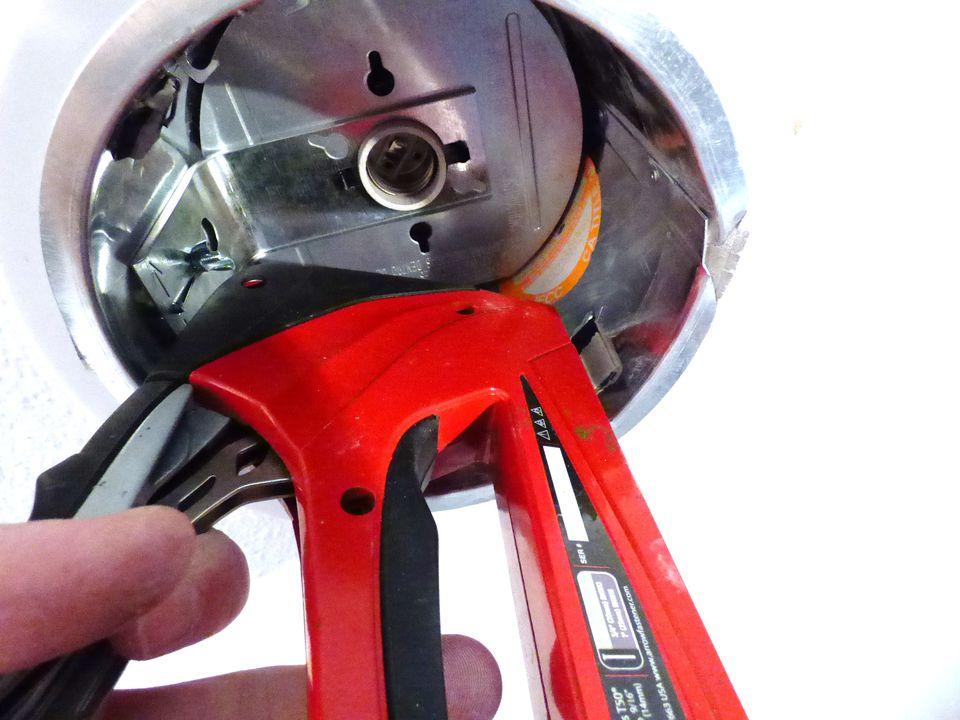 Stapler Inside the Recessed Light