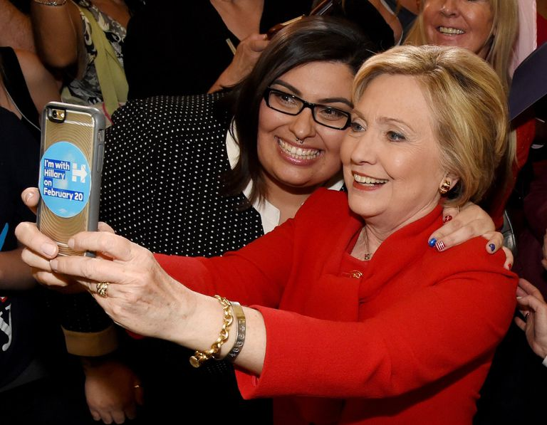 A photo of Hillary Clinton taking a selfie with a voter.
