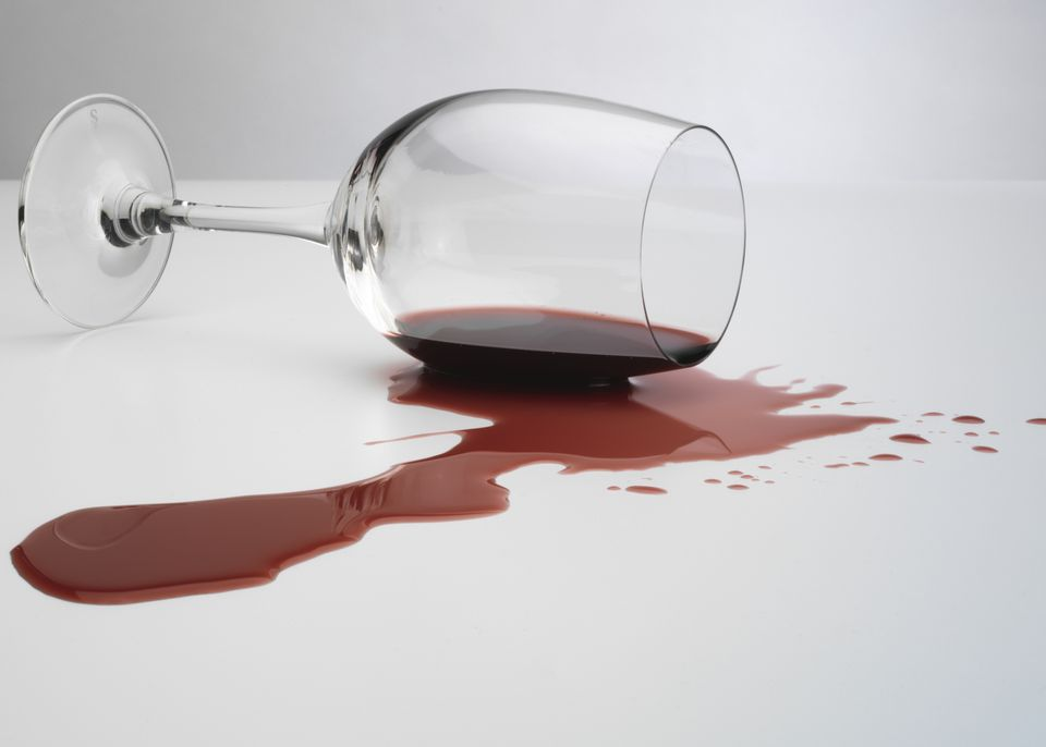 Spilled glass of red wine