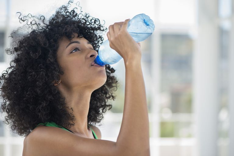 Close up of a woman drinking water